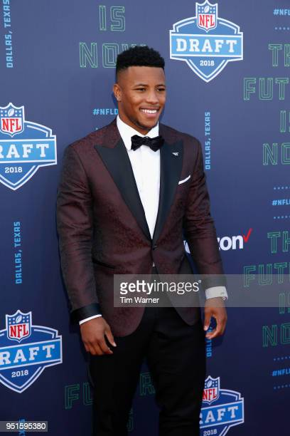 Saquon Barkley of Penn State poses on the red carpet prior to the start of the 2018 NFL Draft at ATT Stadium on April 26 2018 in Arlington Texas