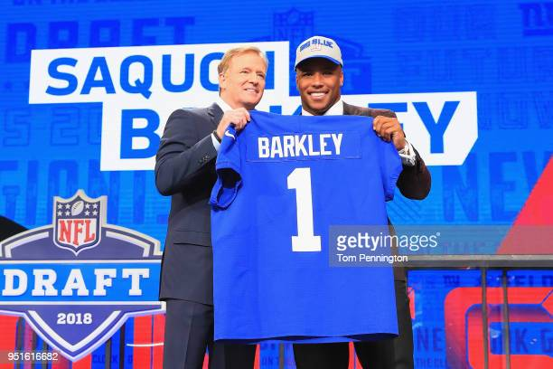 Saquon Barkley of Penn State poses with NFL Commissioner Roger Goodell after being picked overall by the New York Giants during the first round of...
