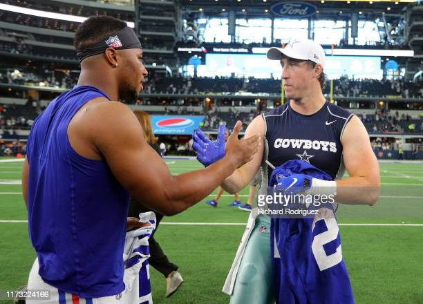 Saquon Barkley of the New York Giants and Sean Lee of the Dallas Cowboys shakes hands after trading jerseys after the game at AT&T Stadium on...