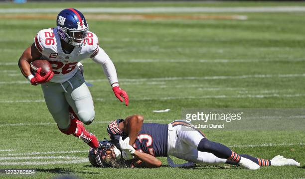 Saquon Barkley of the New York Giants breaks away from Kyle Fuller of the Chicago Bears at Soldier Field on September 20, 2020 in Chicago, Illinois.