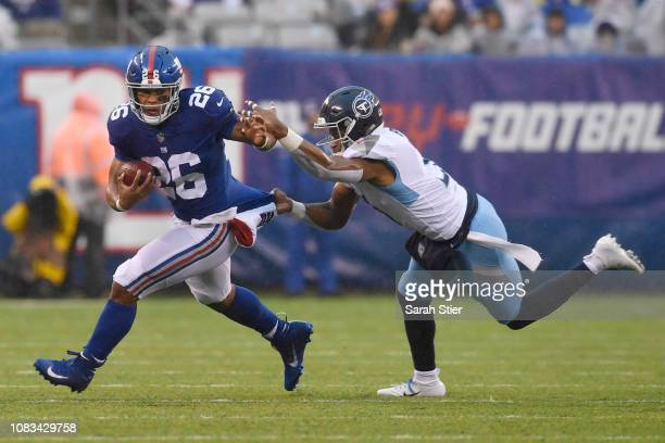 Saquon Barkley of the New York Giants carries the ball against Kevin Byard of the Tennessee Titans during the second quarter of the game at MetLife...