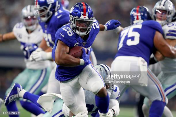 Saquon Barkley of the New York Giants carries the ball against Chidobe Awuzie of the Dallas Cowboys in the third quarter at ATT Stadium on September...