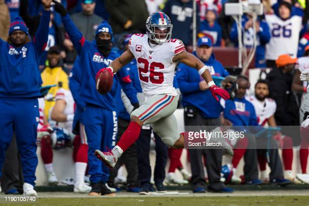 Saquon Barkley of the New York Giants carries the ball during the second half against the Washington Redskins at FedExField on December 22 2019 in...