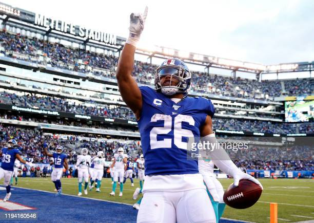 Saquon Barkley of the New York Giants celebrates his touchdown in the fourth quarter against the Miami Dolphins at MetLife Stadium on December 15...