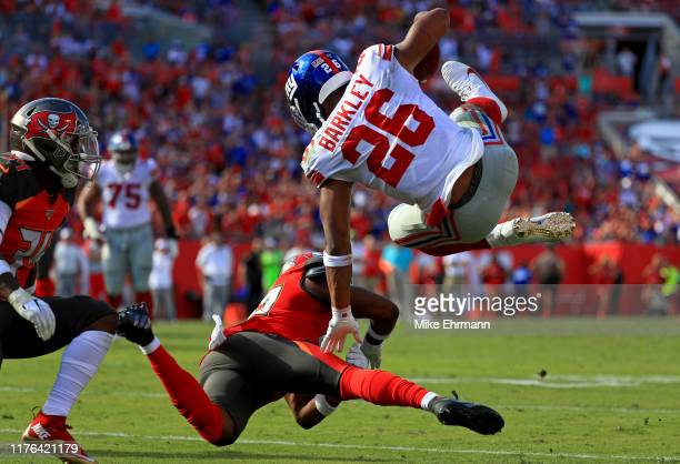 Saquon Barkley of the New York Giants gets up ended by MJ Stewart of the Tampa Bay Buccaneers during a game at Raymond James Stadium on September 22...