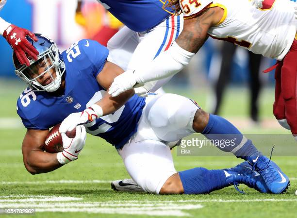 Saquon Barkley of the New York Giants is tackled by Mason Foster of the Washington Redskins on October 28,2018 at MetLife Stadium in East Rutherford,...