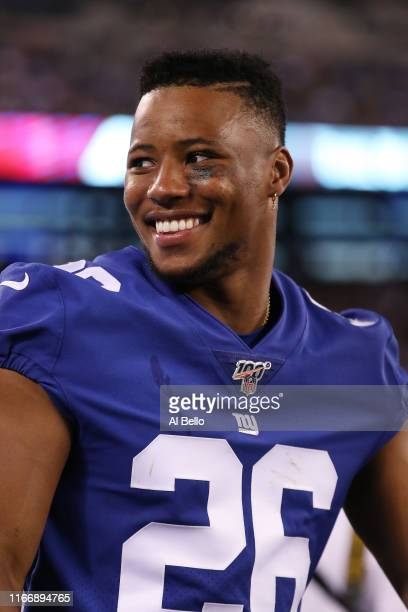 Saquon Barkley of the New York Giants looks on against the New York Jets during their Pre Season game at MetLife Stadium on August 08 2019 in East...