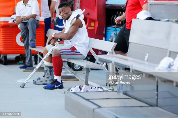 Saquon Barkley of the New York Giants looks on from the bench after being injured against the Tampa Bay Buccaneers during the fourth quarter at...