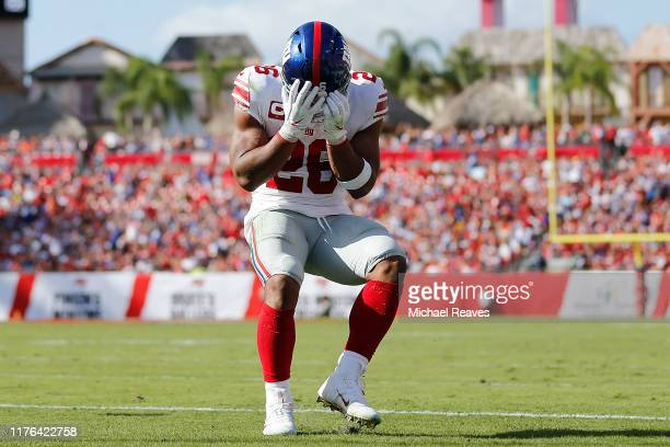 Saquon Barkley of the New York Giants reacts after dropping a pass reception in the endzone against the Tampa Bay Buccaneers during the second...