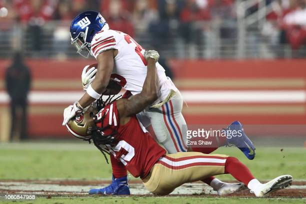 Saquon Barkley of the New York Giants rushes with the ball against Richard Sherman of the San Francisco 49ers during their NFL game at Levi's Stadium...