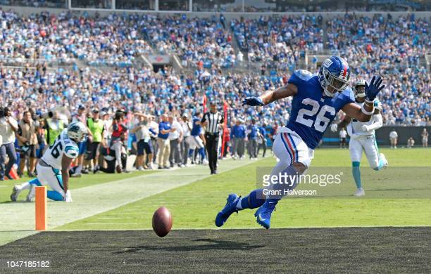 Saquon Barkley of the New York Giants scores a 57-yard receiving touchdown from Odell Beckham Jr. #13 against the Carolina Panthers in the second...