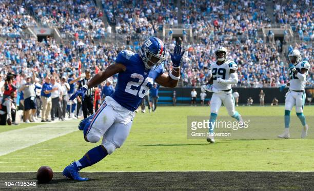 Saquon Barkley of the New York Giants scores a 57yard receiving touchdown from Odell Beckham Jr #13 against the Carolina Panthers in the second...