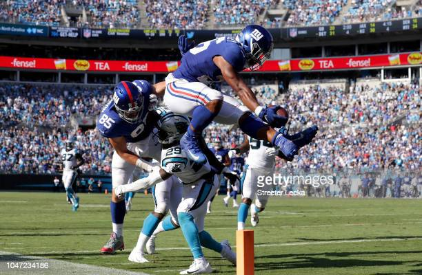 Saquon Barkley of the New York Giants scores a touchdown late in the fourth quarter against the Carolina Panthers during their game at Bank of...