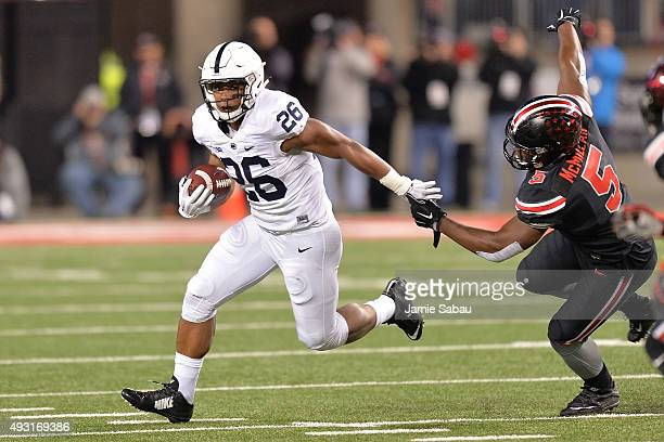 Saquon Barkley of the Penn State Nittany Lions avoids the tackle of Raekwon McMillan of the Ohio State Buckeyes in the first quarter at Ohio Stadium...