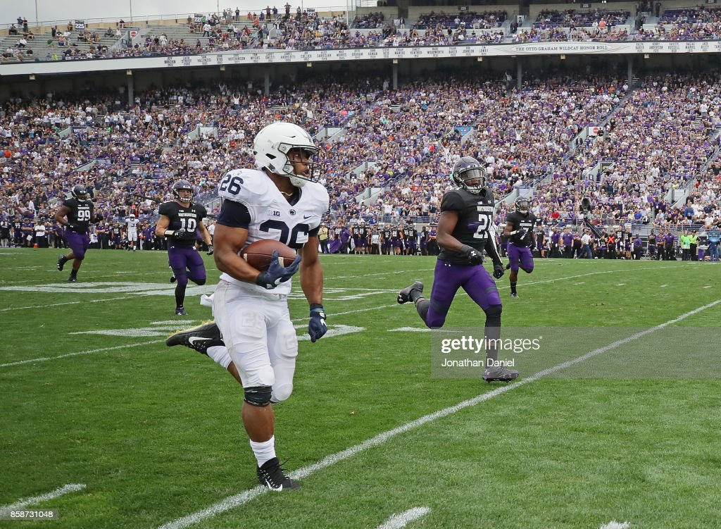 Saquon Barkley #26 of the Penn State Nittany Lions breaks a 53 yard touchdown run against the Northwestern Wildcats at Ryan Field on October 7, 2017 in Evanston, Illinois. Penn State defeated Northwestern 31-7.