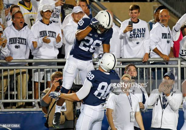 Saquon Barkley of the Penn State Nittany Lions celebrates after rushing for a 69 yard touchdown in the first half against the Michigan Wolverines on...