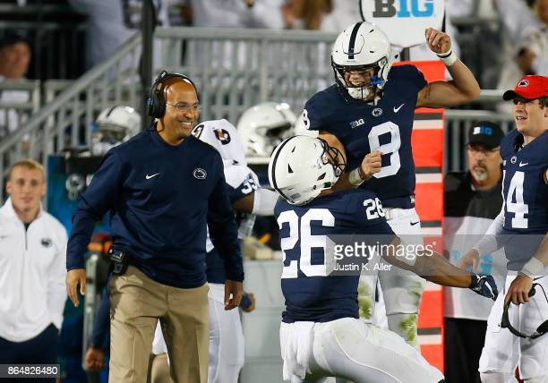 Saquon Barkley of the Penn State Nittany Lions celebrates with Trace McSorley after catching a 42 yard touchdown pass in the second half against the...