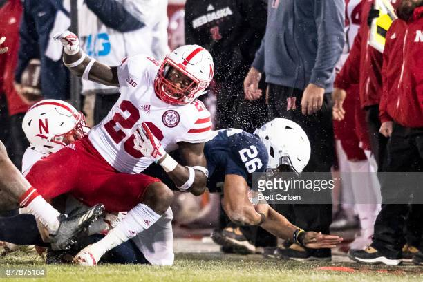 Saquon Barkley of the Penn State Nittany Lions is knocked out of bounds by Kieron Williams of the Nebraska Cornhuskers on November 18 2017 at Beaver...