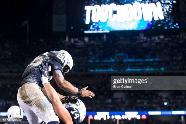 Saquon Barkley of the Penn State Nittany Lions is lifted into the air by Steven Gonzalez after scoring a touchdown during the game against the...