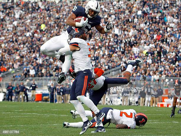 Saquon Barkley of the Penn State Nittany Lions jumps over defenders V'Angelo Bentley, Taylor Barton and Eaton Spence of the Illinois Fighting Illini...
