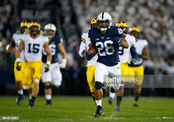 Saquon Barkley of the Penn State Nittany Lions rushes for a 69 yard touchdown in the first half against the Michigan Wolverines on October 21 2017 at...