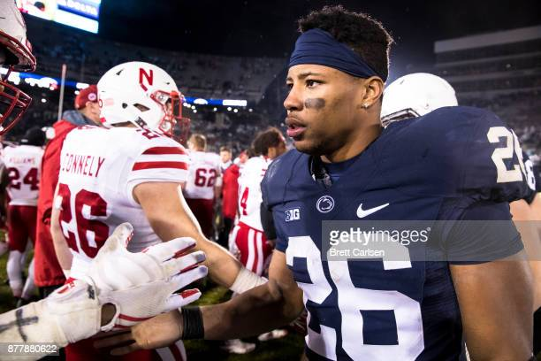 Saquon Barkley of the Penn State Nittany Lions shakes hands with members of the Nebraska Cornhuskers after the game on November 18 2017 at Beaver...