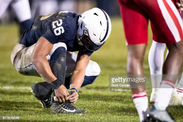Saquon Barkley of the Penn State Nittany Lions ties his cleats during the game against the Nebraska Cornhuskers on November 18 2017 at Beaver Stadium...