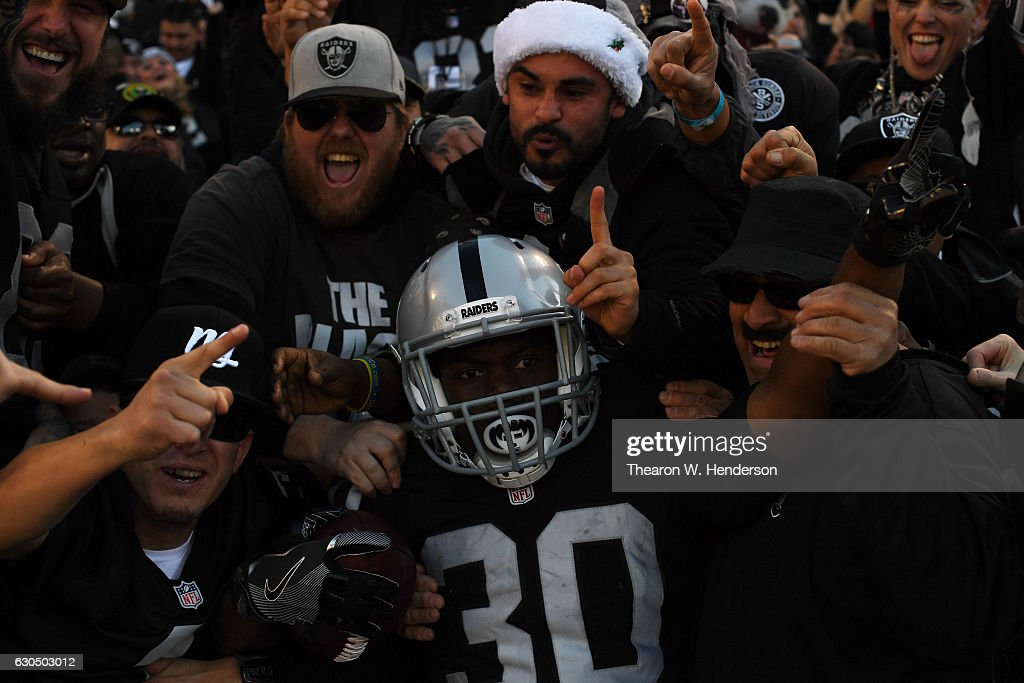 SaQwan Edwards #30 of the Oakland Raiders celebrates in the stands after scoring against the Indianapolis Colts during their NFL game at Oakland Alameda Coliseum on December 24, 2016 in Oakland, California.