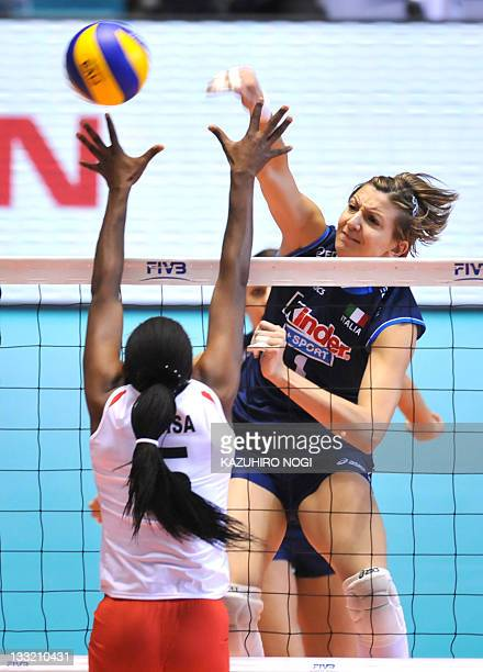 Sara Anzanello of Italy attacks over Diana Khisa of Kenya during a match of the World Cup women's volleyball tournament in Tokyo on November 18 2011...