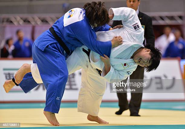 Sara Asahina of Japan and Meguni Tachimoto of Japan compete in the women's 78kg semifinal match during day three of the Judo Grand Slam at the on...