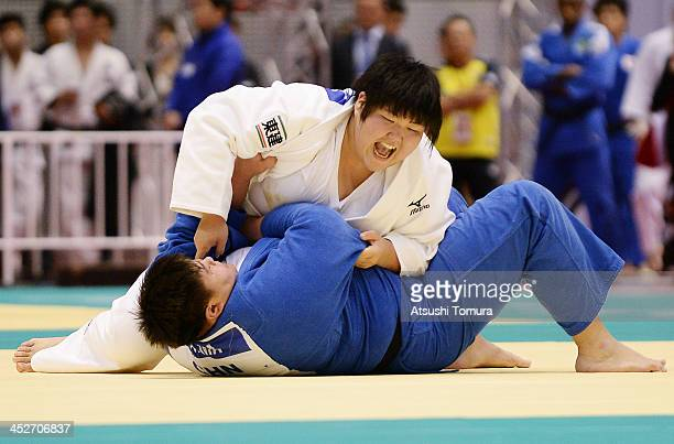 Sara Asahina of Japan and Sisi Ma of China compete in the women's 78kg quaterfinal match during day three of the Judo Grand Slam at the on December 1...