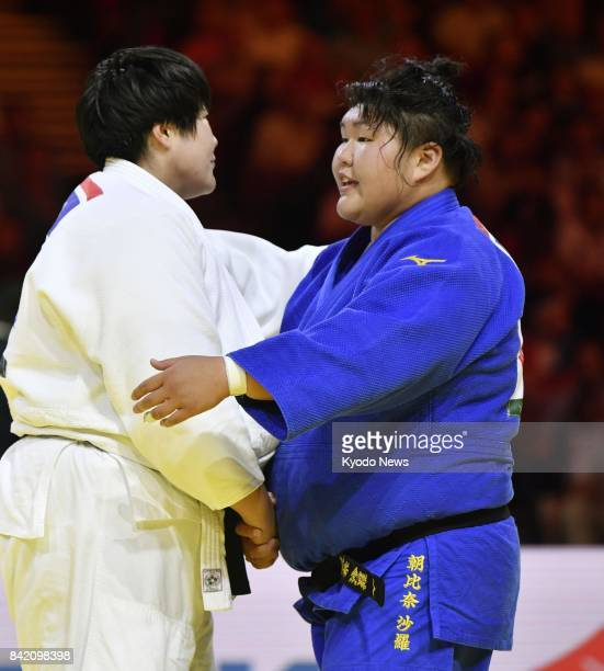 Sara Asahina of Japan and Yu Song of China shake hands after competing in the women's over78kilogram final at the judo world championships in...