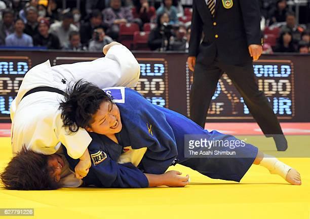 Sara Asahina of Japan throws Kanae Yamabe of Japan in the Women's 78kg semi final during day three of the Judo Grand Slam at Tokyo Metropolitan...