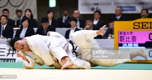Sara Asahina overpowers Megumi Tachimoto during the final of the over78 kilograms division at the national women's championships in Yokohama south of...