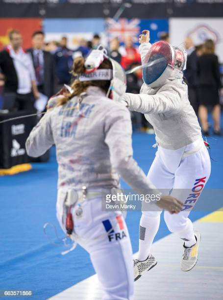 Sara Balzer of France fences Jiyeon Kim of South Korea during competition at the SK Telecom Seoul Sabre Grand Prix on April 1st 2017 at the SK...
