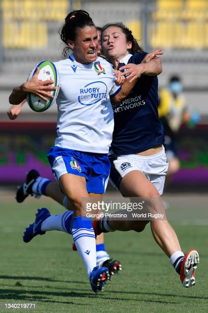 Sara Barattin of Italy scores a try tackled by Rhona Lloyd of Scotland during the Scotland v Italy Rugby World Cup 2021 Europe Qualifying match at...
