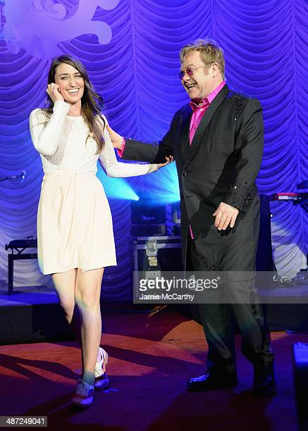 Sara Bareilles and Elton John pose onstage at The Breast Cancer Foundation's 2014 Hot Pink Party at Waldorf Astoria Hotel on April 28 2014 in New...
