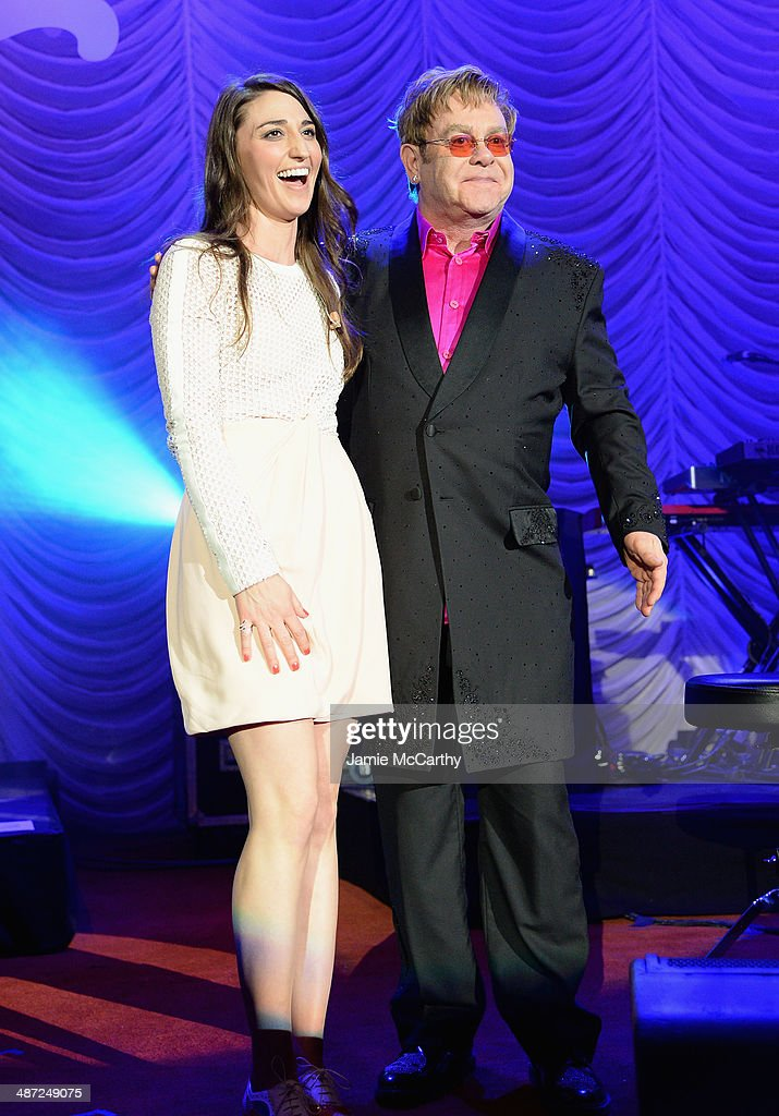 Sara Bareilles (L) and Elton John pose onstage at The Breast Cancer Foundation's 2014 Hot Pink Party at Waldorf Astoria Hotel on April 28, 2014 in New York City.
