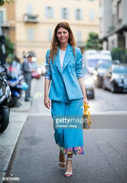 Sara Battaglia wearing blue suit is seen outside Stella McCartney during Milan Men's Fashion Week Spring/Summer 2019 on June 18 2018 in Milan Italy
