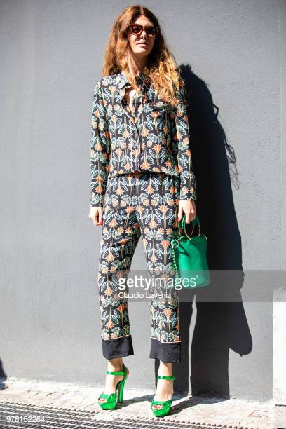 Sara Battaglia wearing floral suit and Sara Battaglia green hand bag is seen in the streets of Milan before the N21 show during Milan Men's Fashion...