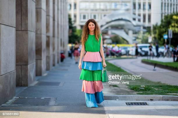 Sara Battaglia wearing green blue pink striped dress is seen outside Alberta Ferretti during Milan Men's Fashion Week Spring/Summer 2019 on June 15...