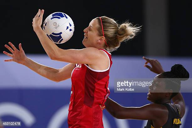 Sara Bayman of England catches a pass during the bronze medal netball match between England and Jamaica at the SECC Precinct during day eleven of the...