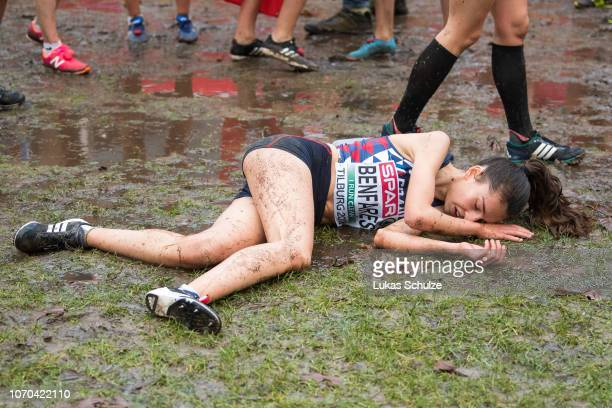 Sara Benfares of France lies on the ground after she finished the U20 Women's race of the SPAR European Cross Country Championships on December 9...
