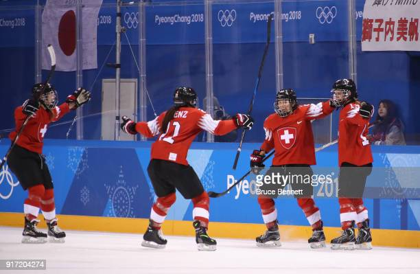 Sara Benz of Switzerland celebrates with teammates after scoring a goal in the second period against Japan during the Women's Ice Hockey Preliminary...