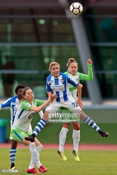 Sara Bjork Gunnarsdottir and Babett Peter of VfL Wolfsburg challenges Maryem Hajri of SC Huelva during the friendly match between VfL Wolfsburg...
