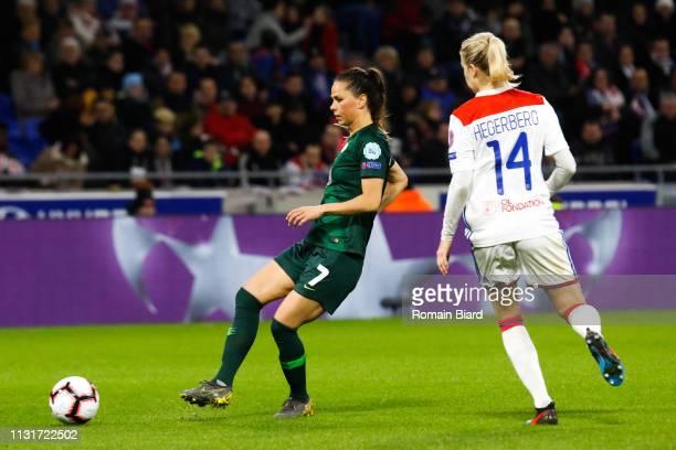 Sara Bjork Gunnarsdottir of Wolfsburg and Hegerberg Ada of Lyon during the Women's Champions League match between Lyon and Wolfsburg on March 20 2019...
