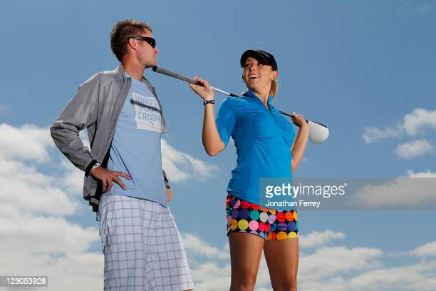 Sara Brown poses for a portrait with her caddy Derek Radley during the Safeway Classic at Pumpkin Ridge Golf Club on August 18 2011 in North Plains...