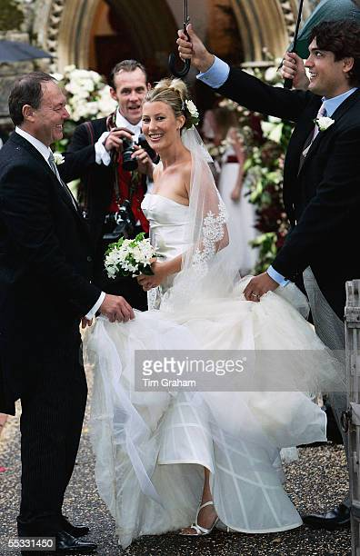 Sara Buys is sheltered from the rain as she arrives for her wedding to Tom ParkerBowles on September 10 2005 in Oxofordshire England Their marriage...