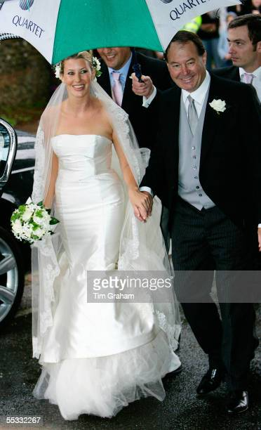 Sara Buys walks with her father at her wedding to Tom ParkerBowles Their marriage was held at St Nicholas Church at Rotherfield Greys in Oxfordshire...