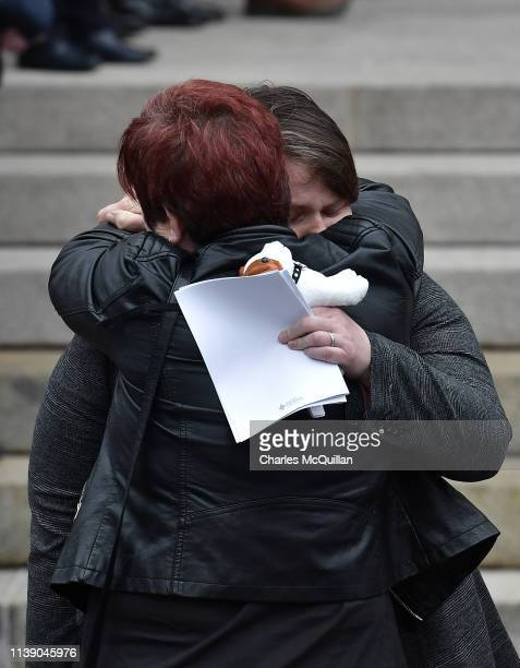 Sara Canning is consoled as she attends the funeral of her partner the murdered journalist Lyra McKee at St Anne's Cathedral on April 24 2019 in...
